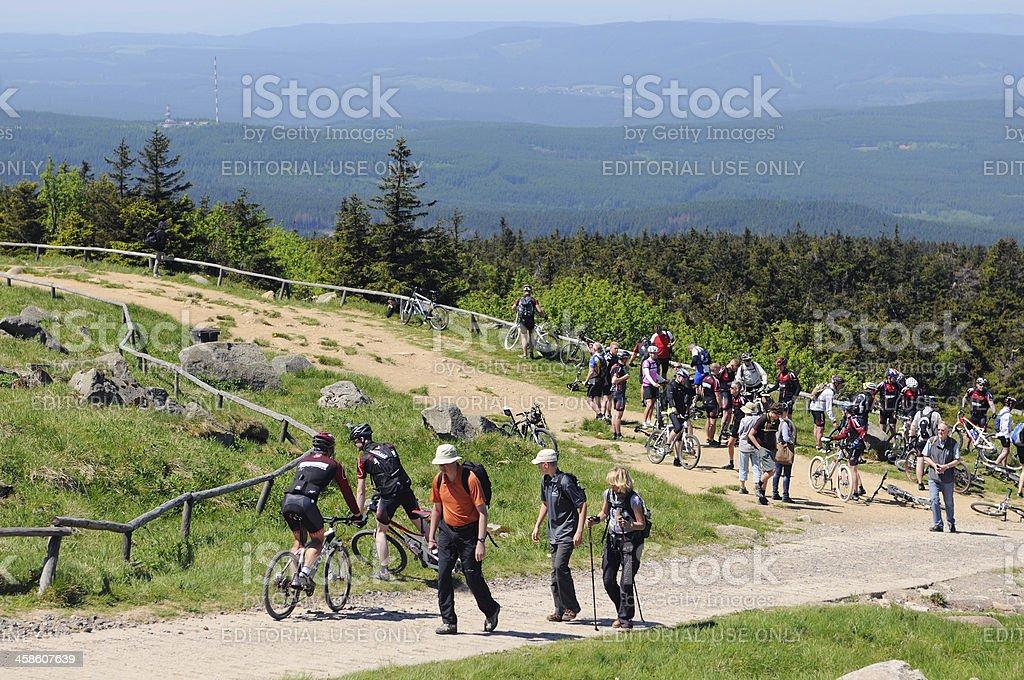 bikers on the way to peak of Brocken Mountain stock photo