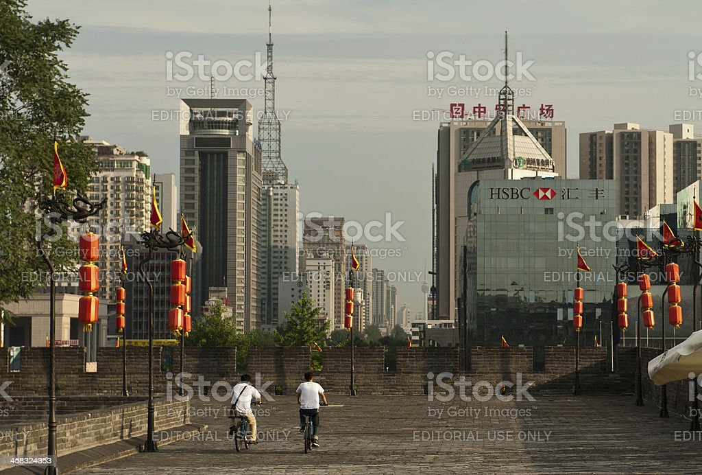 Bikers riding on ancient Xian city wall royalty-free stock photo