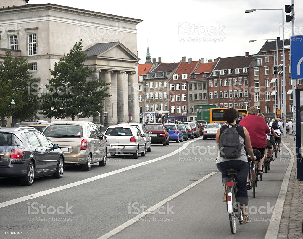 Bikes and Cars During Rush Hour royalty-free stock photo