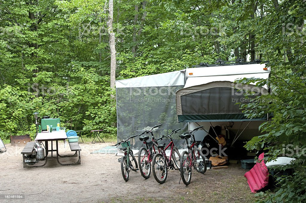 Bikes by Tent Camper royalty-free stock photo