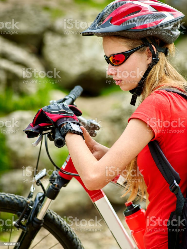 Bikes cycling girl. Bicyclist watchs on smart watch. stock photo