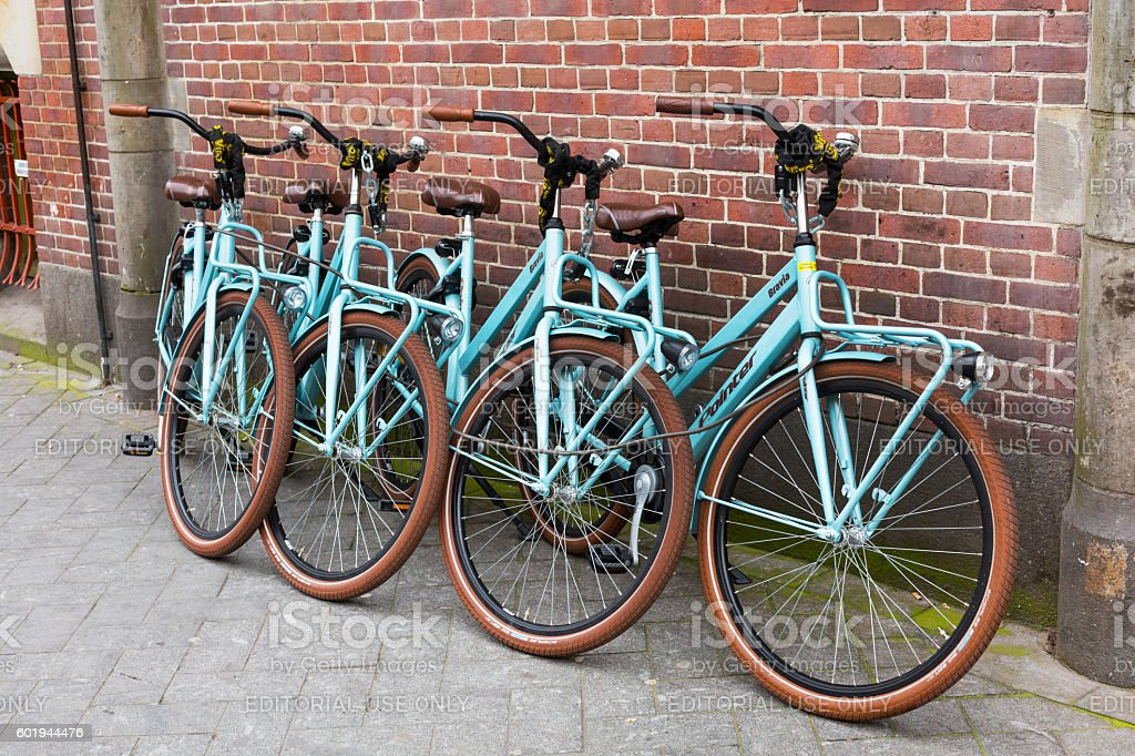 Bikes for rent near brick wall stock photo