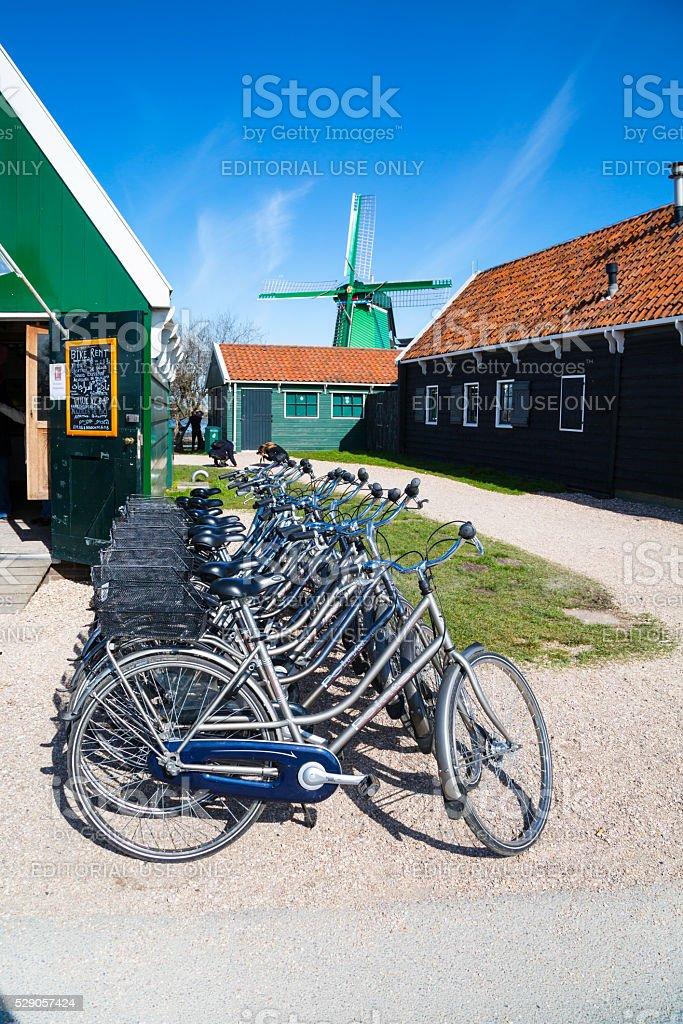 Bikes for rent, windmill in Zaanse Schans, traditional village, Netherlands stock photo