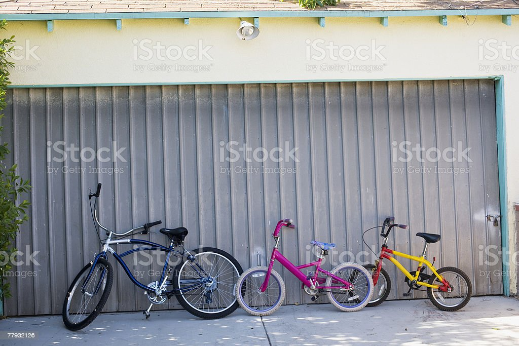 Bikes in front of a closed garage door royalty-free stock photo
