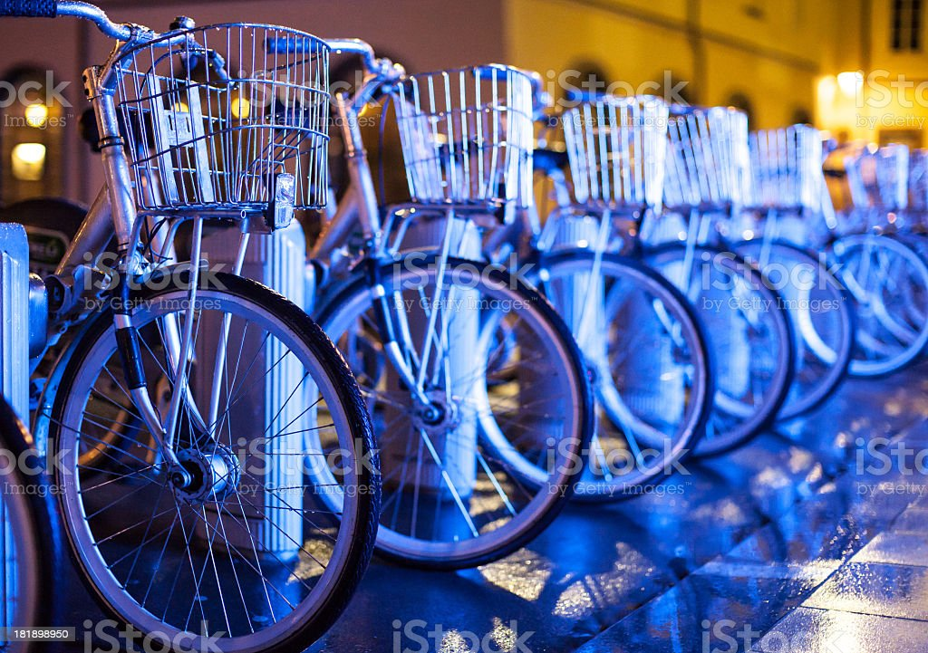 Bikes in front of neon lights royalty-free stock photo