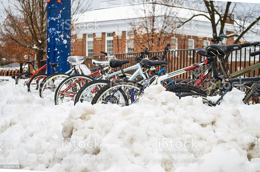 Bikes in rack covered in snow stock photo