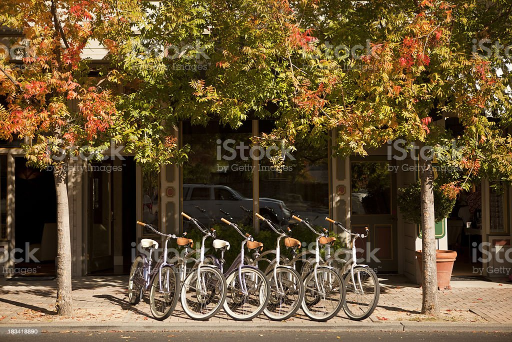 Bikes line the street in a small town royalty-free stock photo