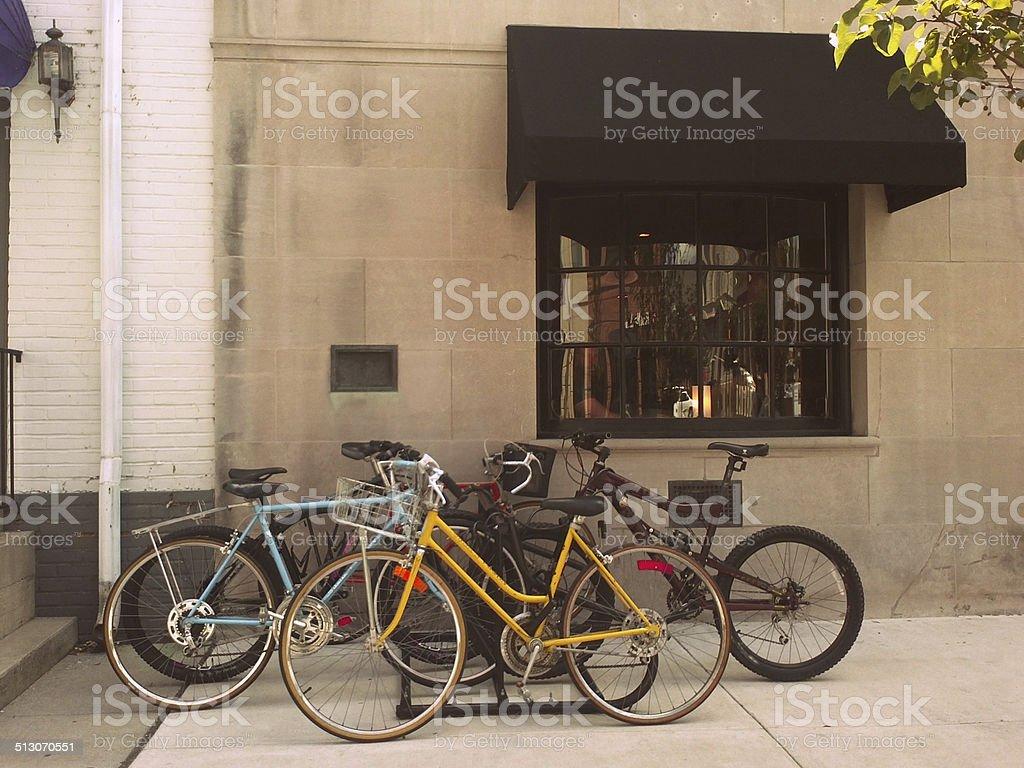 Bikes on Rack in front of Building With Black Awning stock photo
