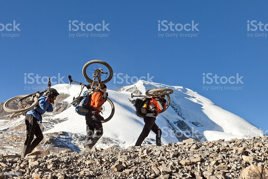 Bikes on shoulders royalty-free stock photo