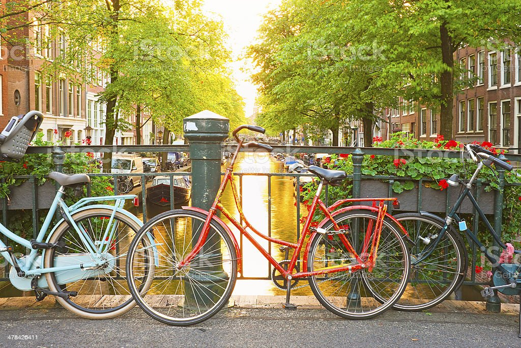 Bikes on the bridge in Amsterdam Netherlands stock photo