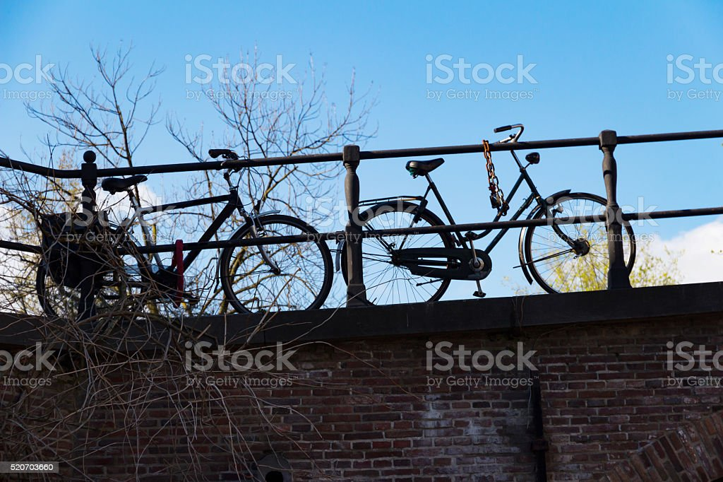 Bikes parked on a bridge stock photo