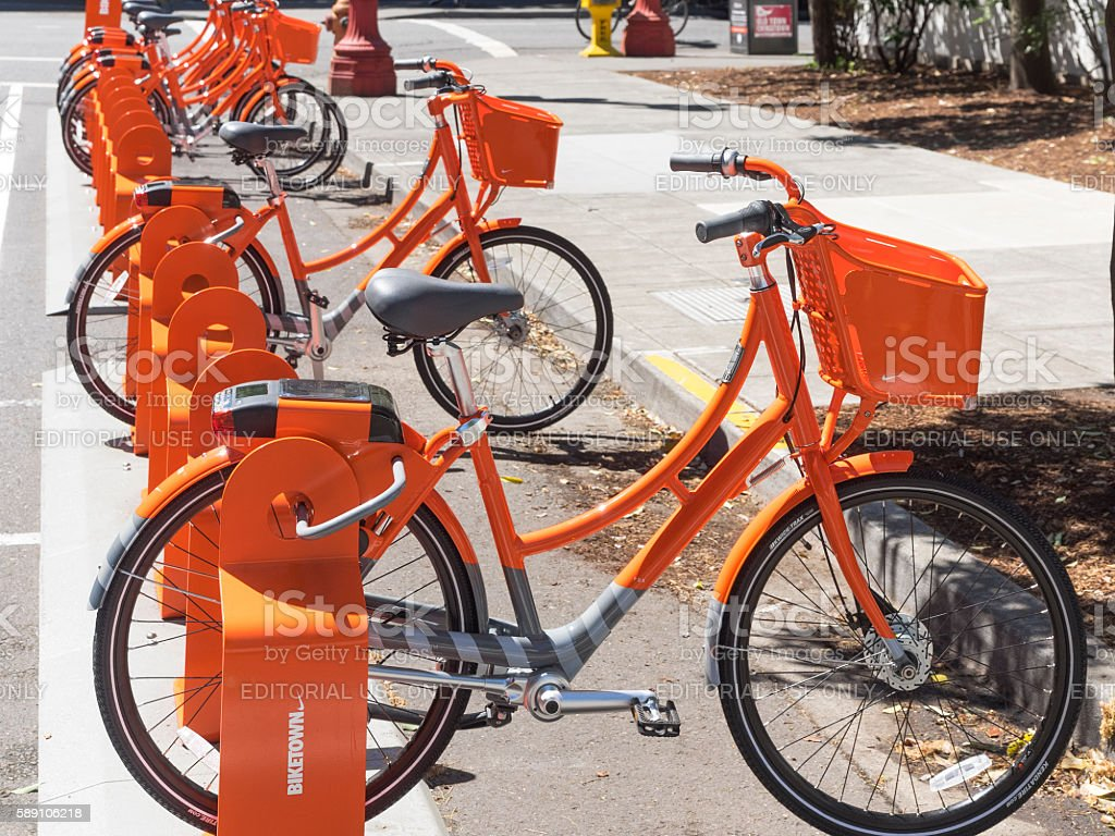 Biketown Orange Bikes at Share Station Downtown Portland Oregon stock photo