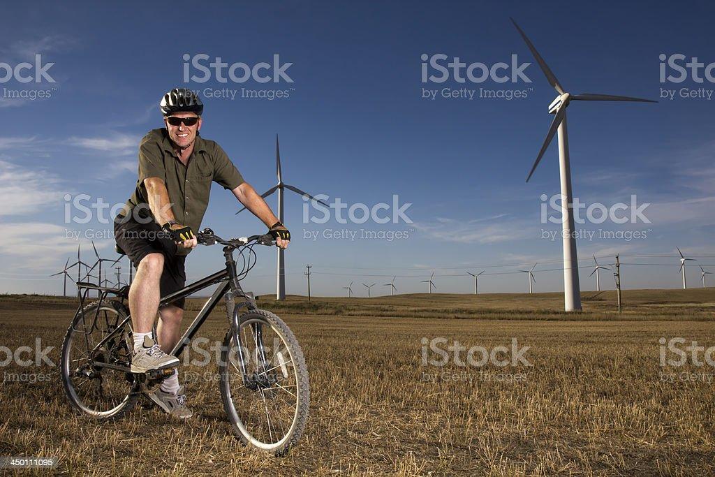 Biking at Wind Turbines royalty-free stock photo