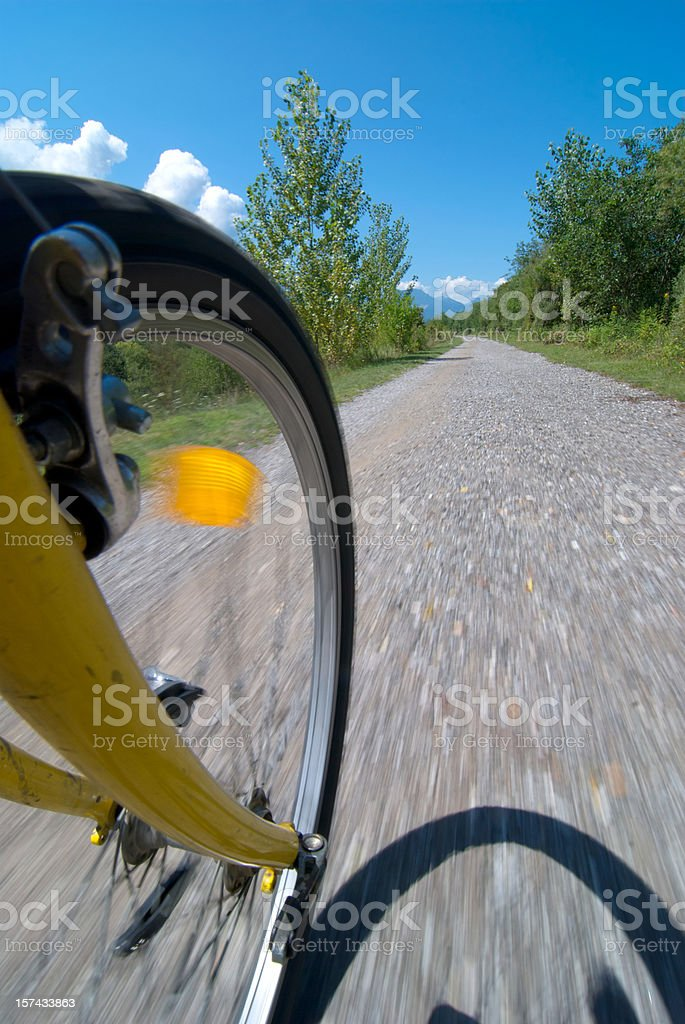 biking, close up of wheel in motion royalty-free stock photo