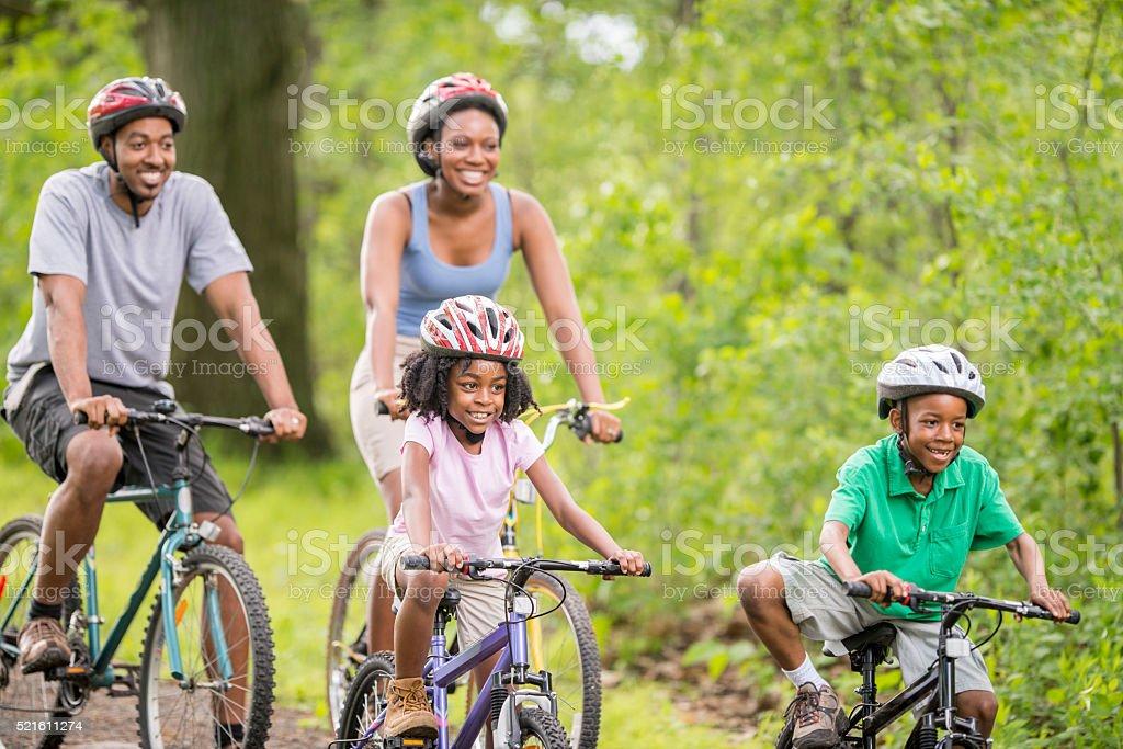 Biking Down a Woodland Path stock photo