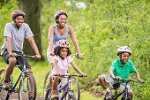 Biking Down a Woodland Path