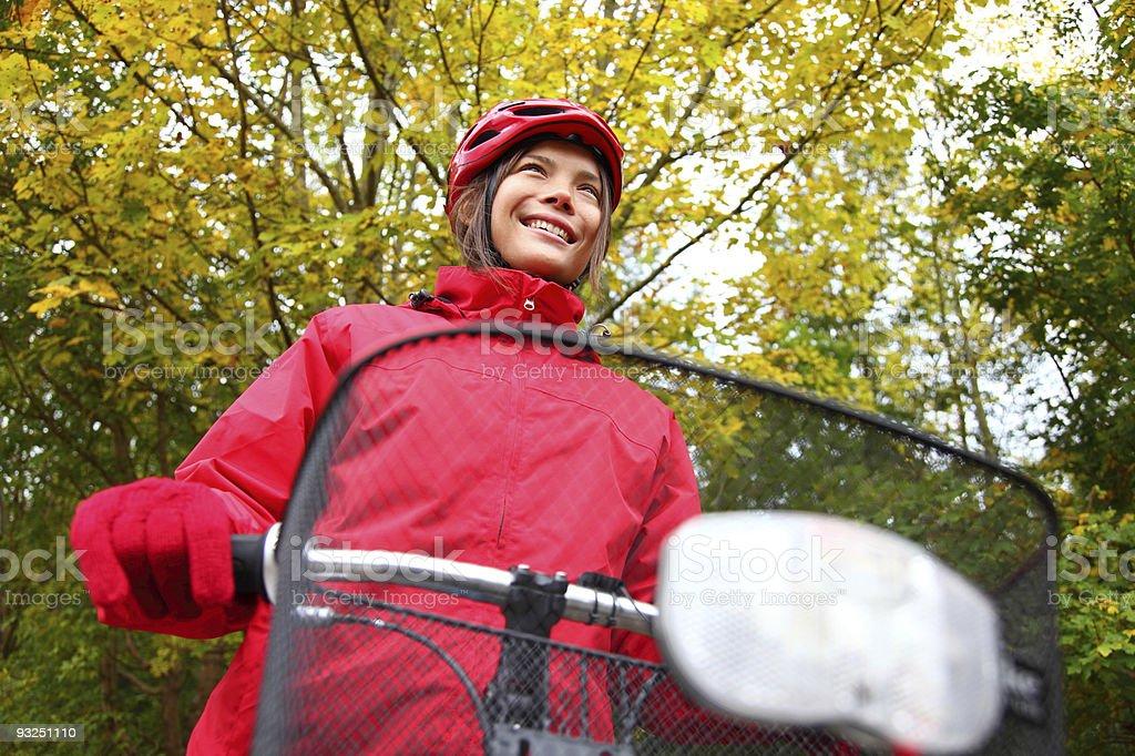 Biking girl in autumn royalty-free stock photo
