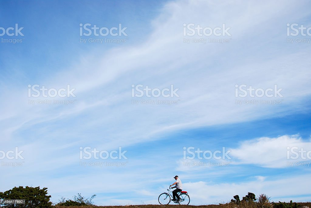 Biking in a plain landscape stock photo