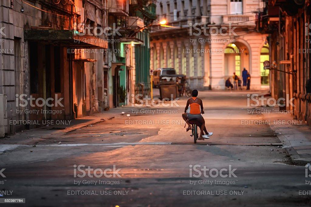 Biking in Centro Havana, Cuba in the early morning stock photo