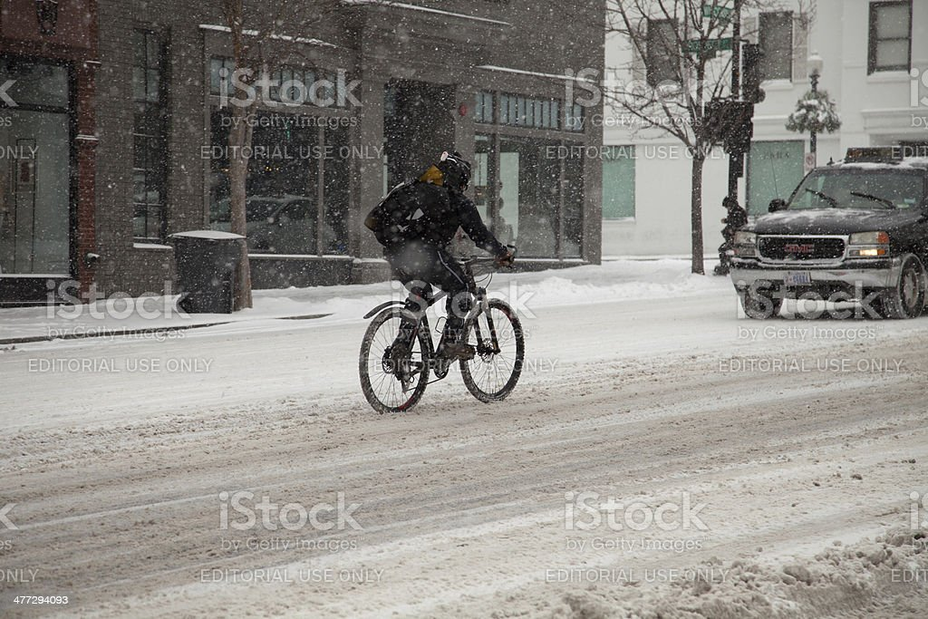 Biking in snow stock photo