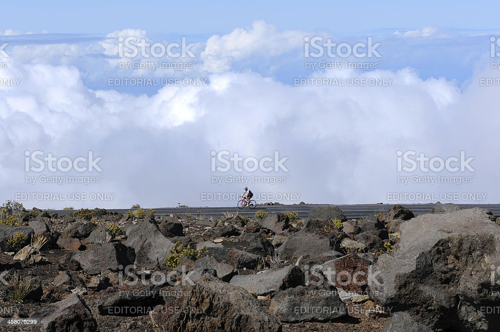 Biking in the Clouds royalty-free stock photo