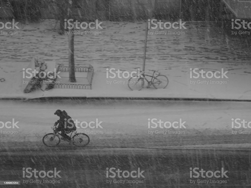 Biking in the snow with determination royalty-free stock photo