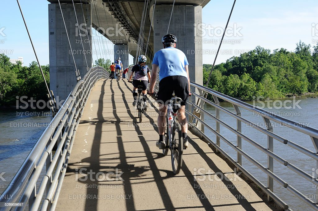 Biking on Bridge over James River in Richmond stock photo