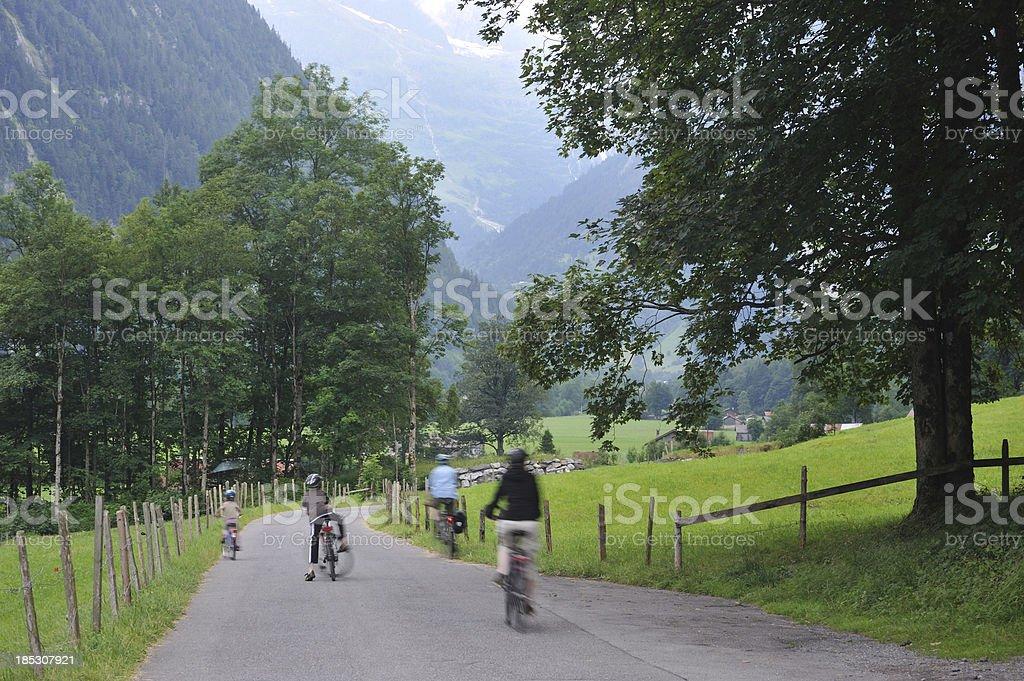 Biking on Swiss Country Road royalty-free stock photo