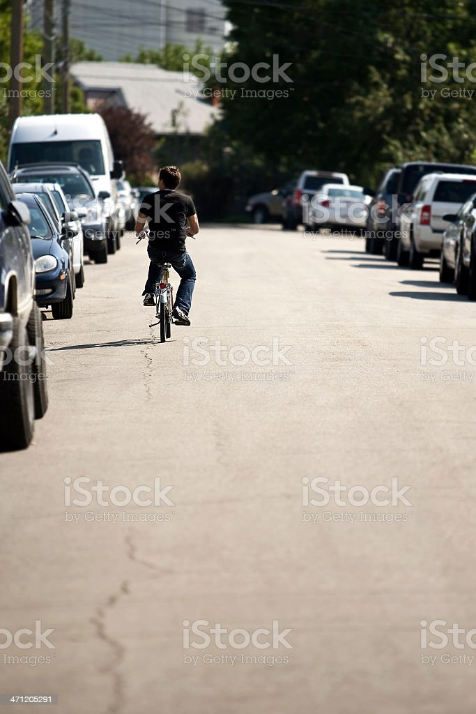 Biking Riding Alone royalty-free stock photo