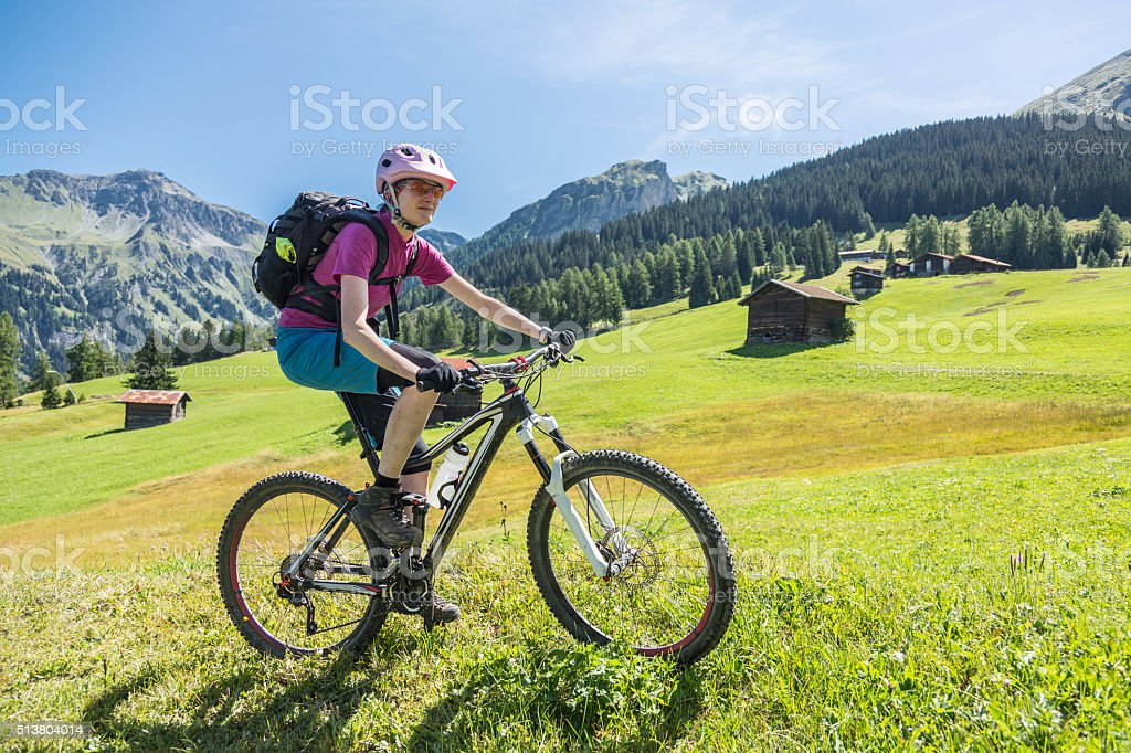 Biking the pastures of Graubünden, Switzerland stock photo