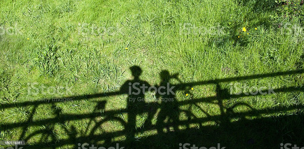 biking: two mountain bikers' shadows royalty-free stock photo