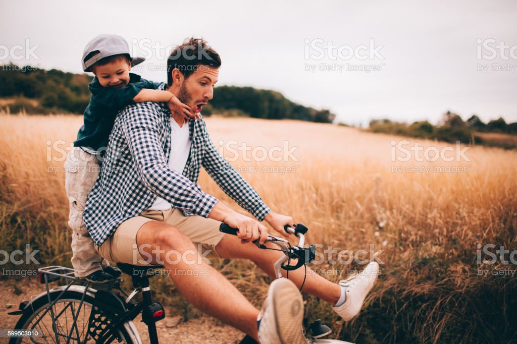 Biking with my dad stock photo