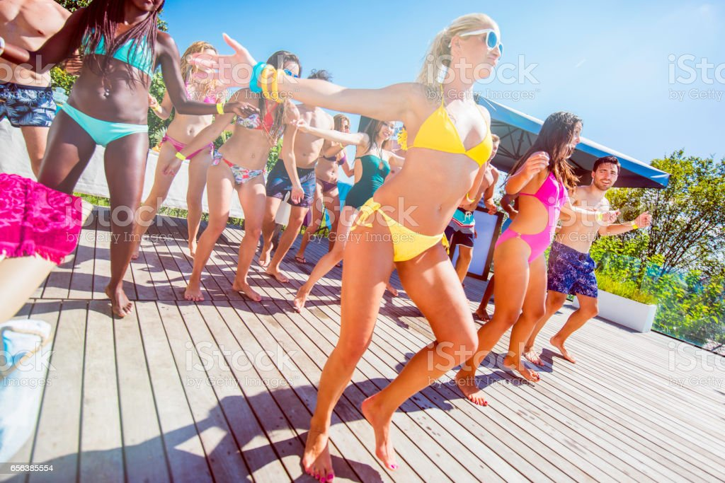 Bikini dance on a pool party stock photo
