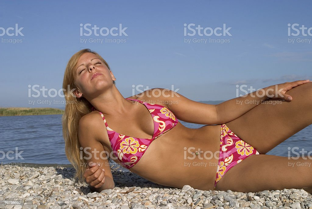 Bikini girl lying beach royalty-free stock photo