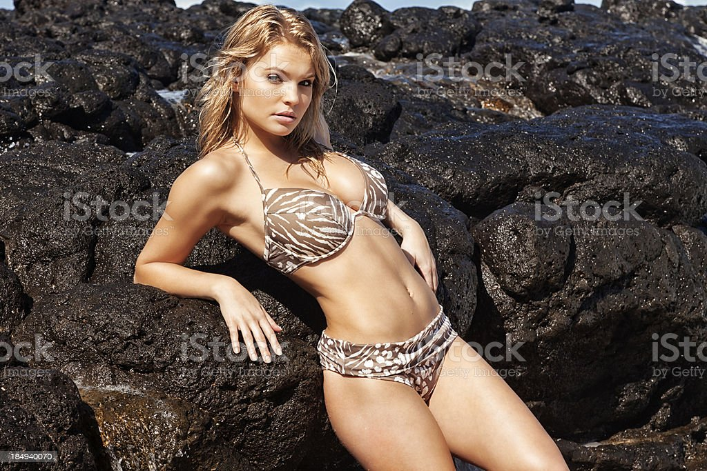 Bikini Model Posing on Black Volcanic Rock royalty-free stock photo
