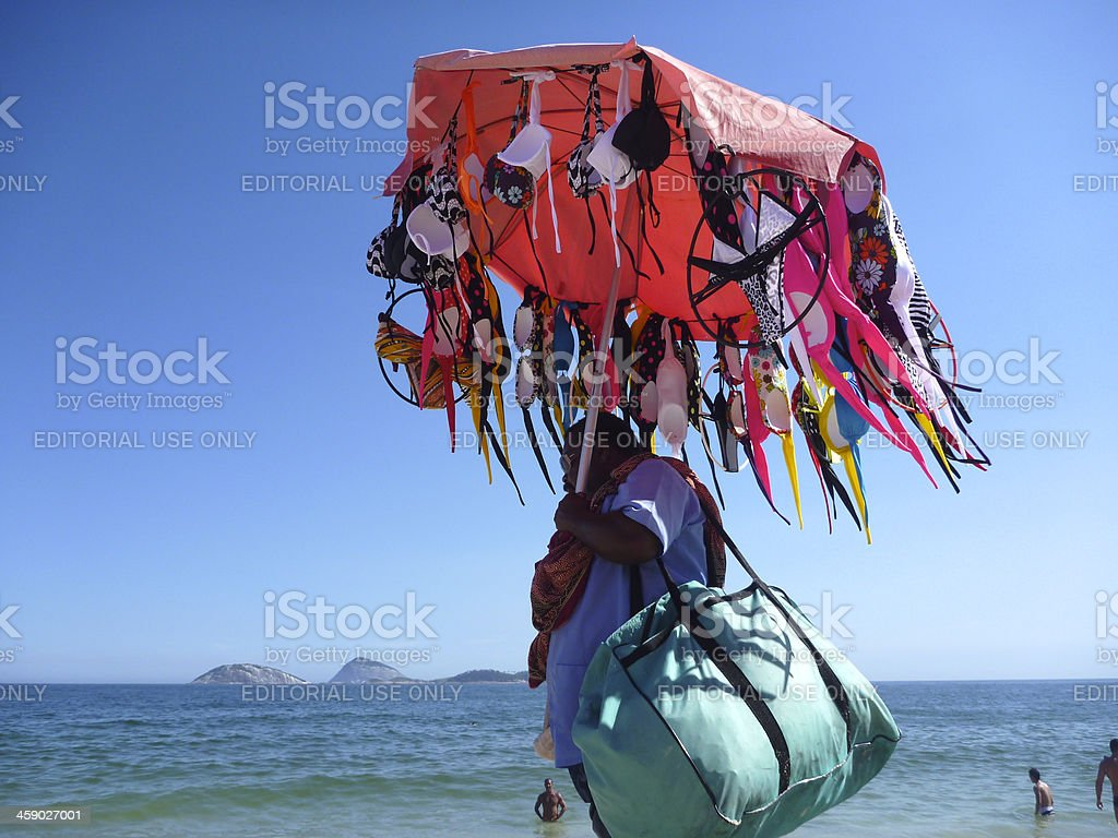 Bikini Vendor Walks Along Ipanema Beach Rio de Janeiro stock photo