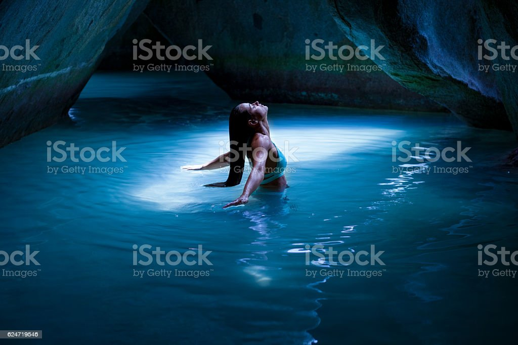 Bikini woman in the cave at the Baths, Virgin Gorda stock photo