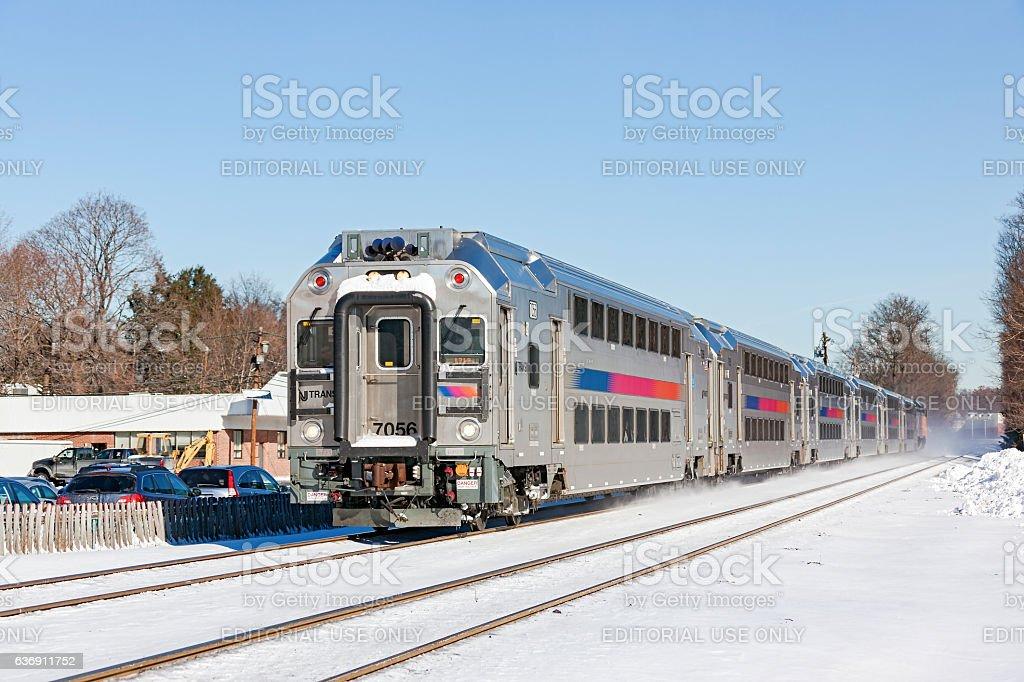 Bi-level NJ Transit commuter train in winter snow stock photo