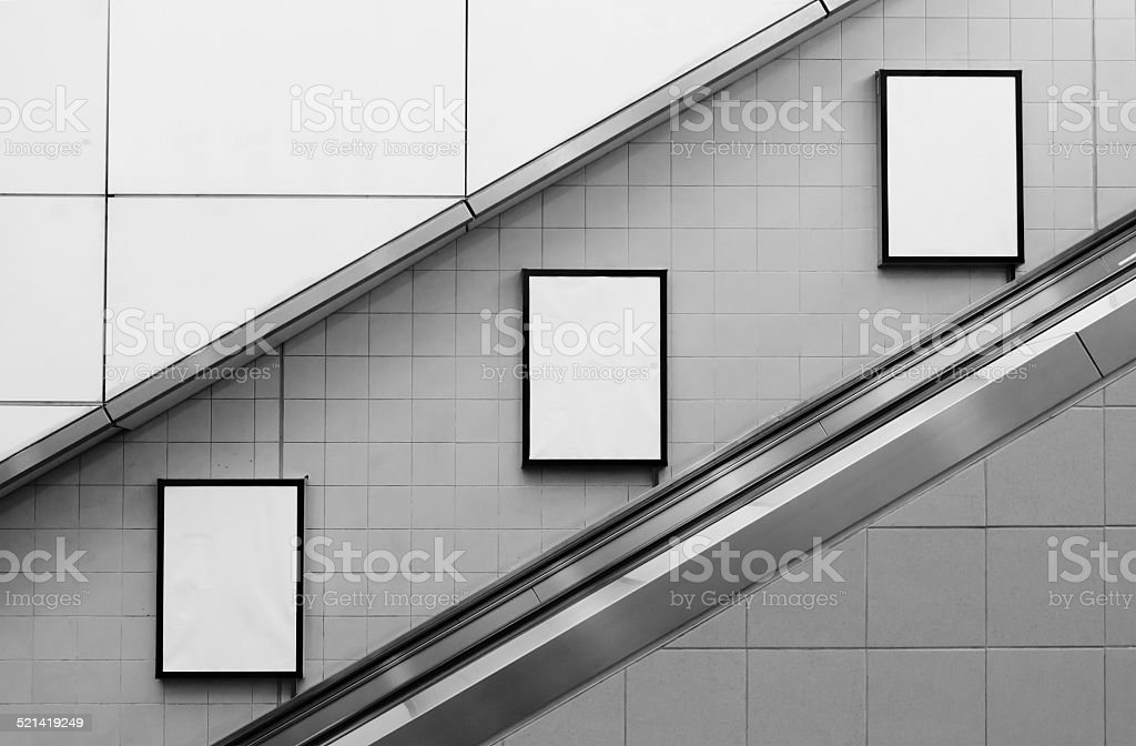 bill board ads at escalator stock photo