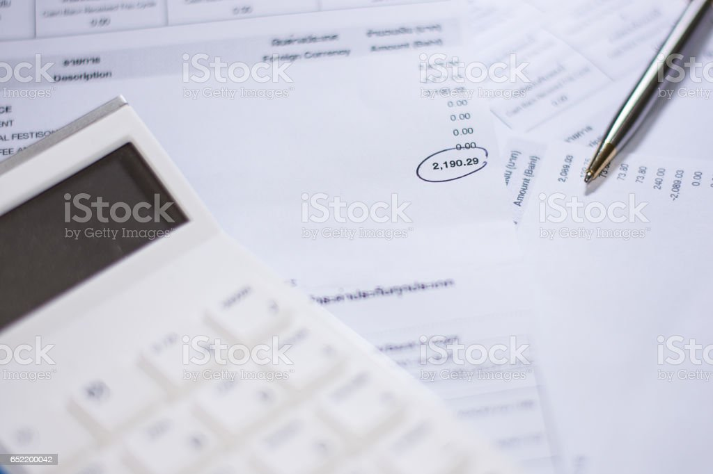 Bill finance and calculator with pen stock photo