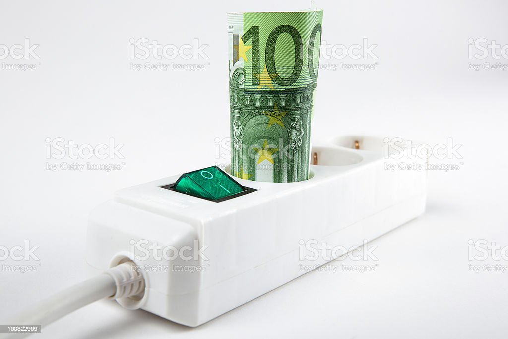 A $100 bill in an energy socket outlet stock photo