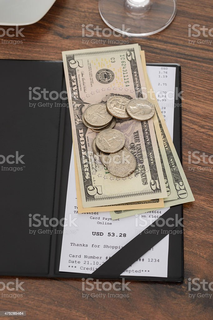 Bill With American Dollars On Table stock photo