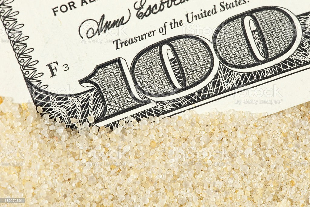 $100 Bill within Frac Sand stock photo