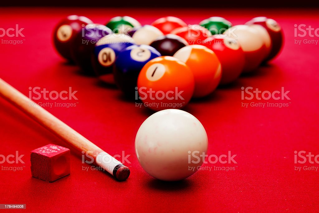 Billard equipment. Colorful balls, chalk and a cue stock photo