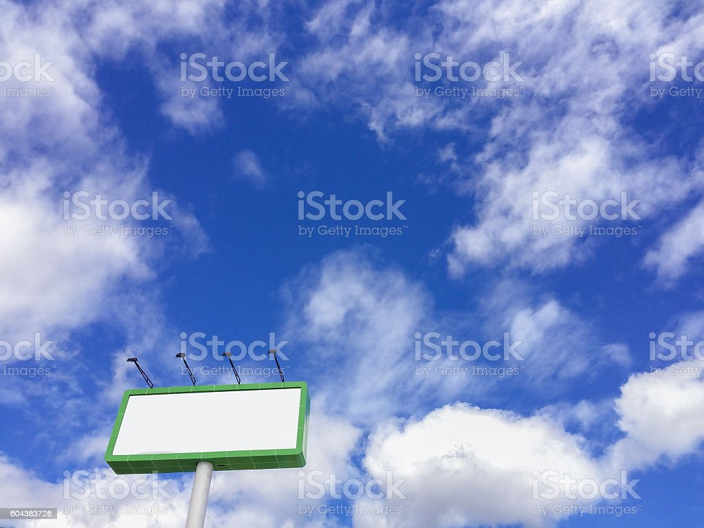Billboard against blue cloudy sky stock photo