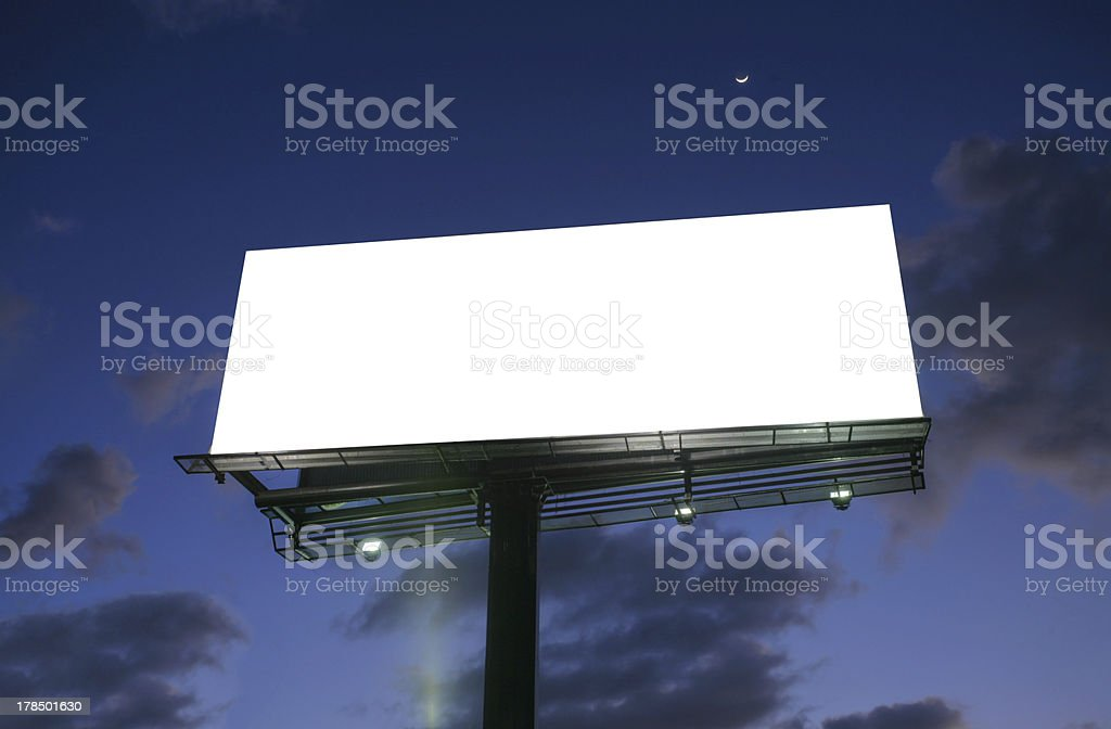 Billboard at sunset with new moon royalty-free stock photo