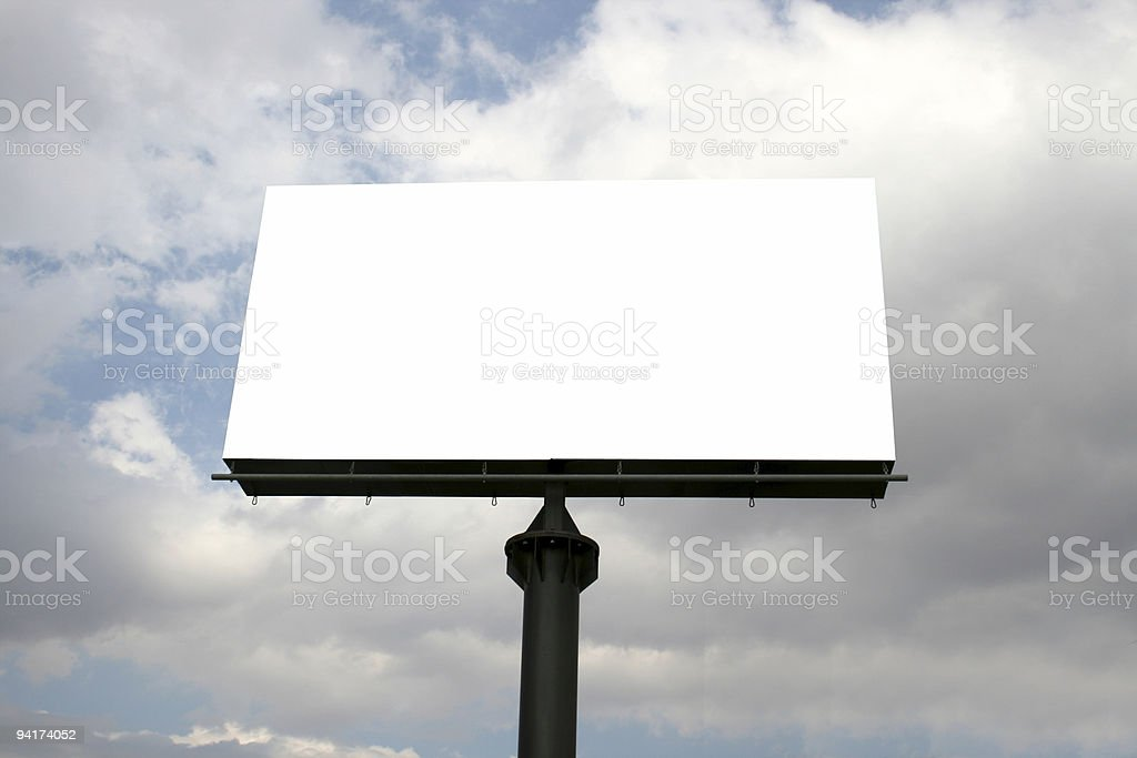Billboard isolated against a cloudy sky royalty-free stock photo