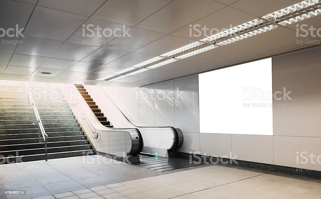 Billboard mock up in subway with escalator stock photo