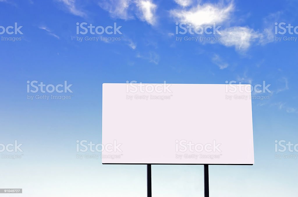 Billboard on a beautiful blue sky - large version royalty-free stock photo