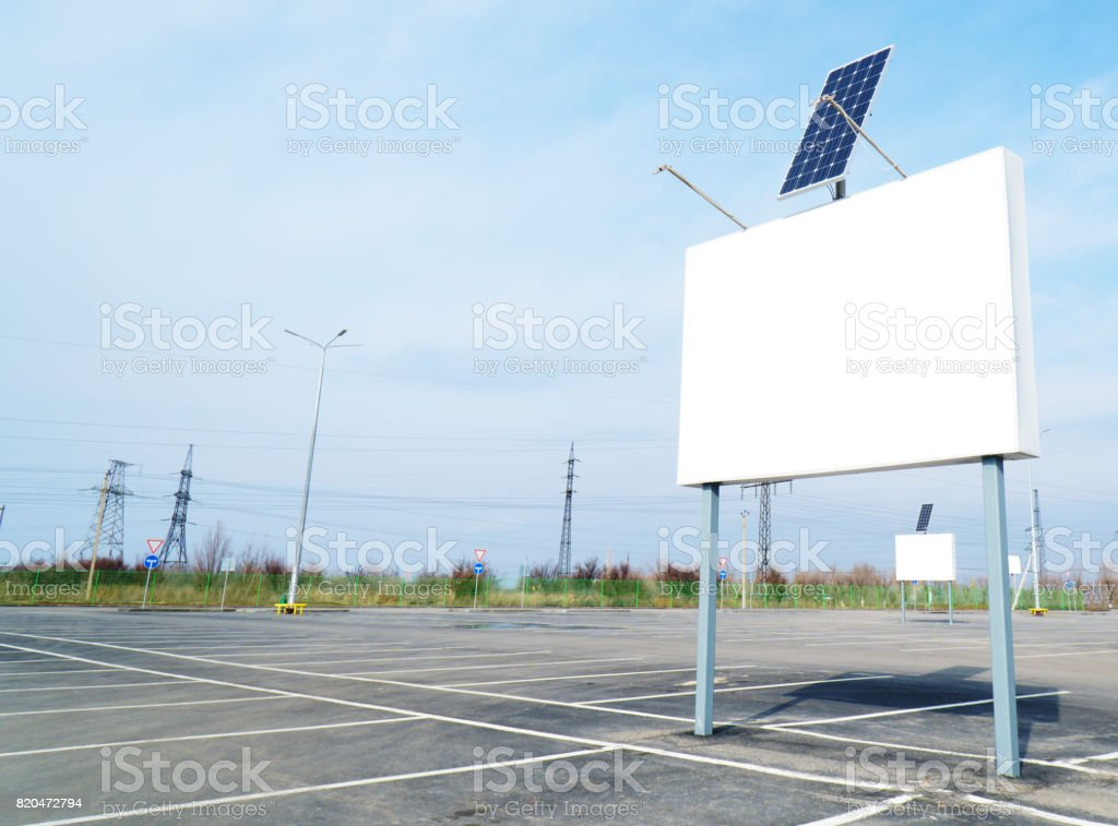 Billboard on empty parking with solar panel stock photo